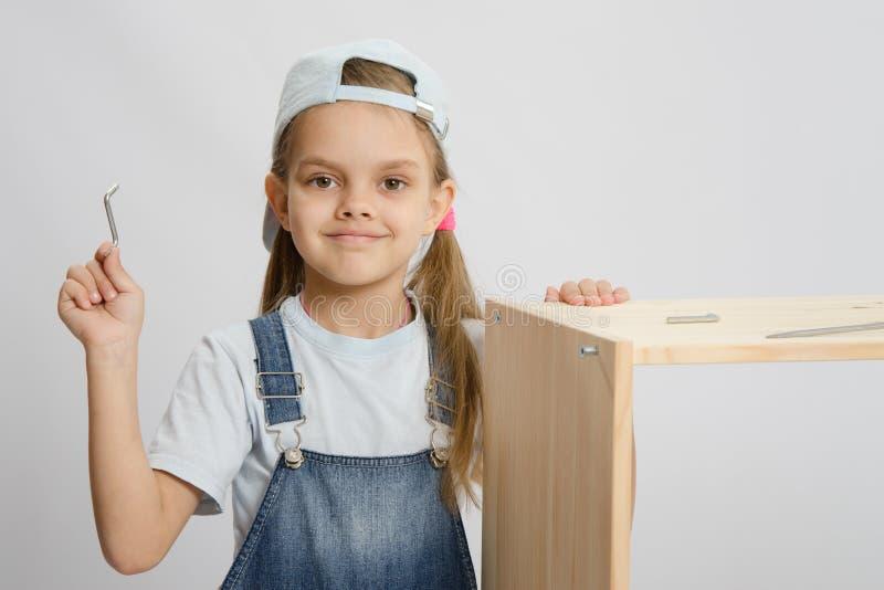 家具图象收藏家的小女孩有工具的 库存图片