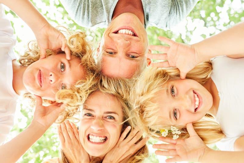 家庭和孩子扮小丑  免版税图库摄影