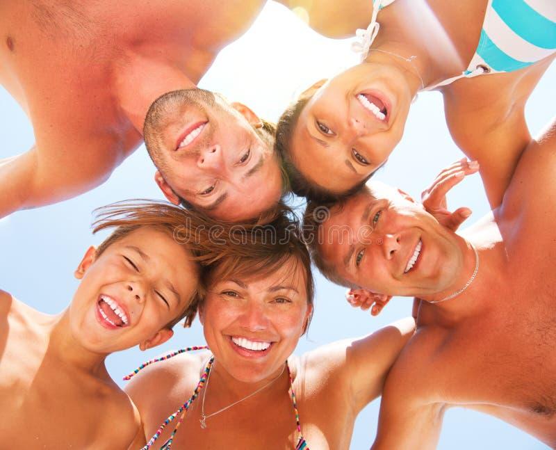 家庭获得乐趣在海滩 免版税图库摄影