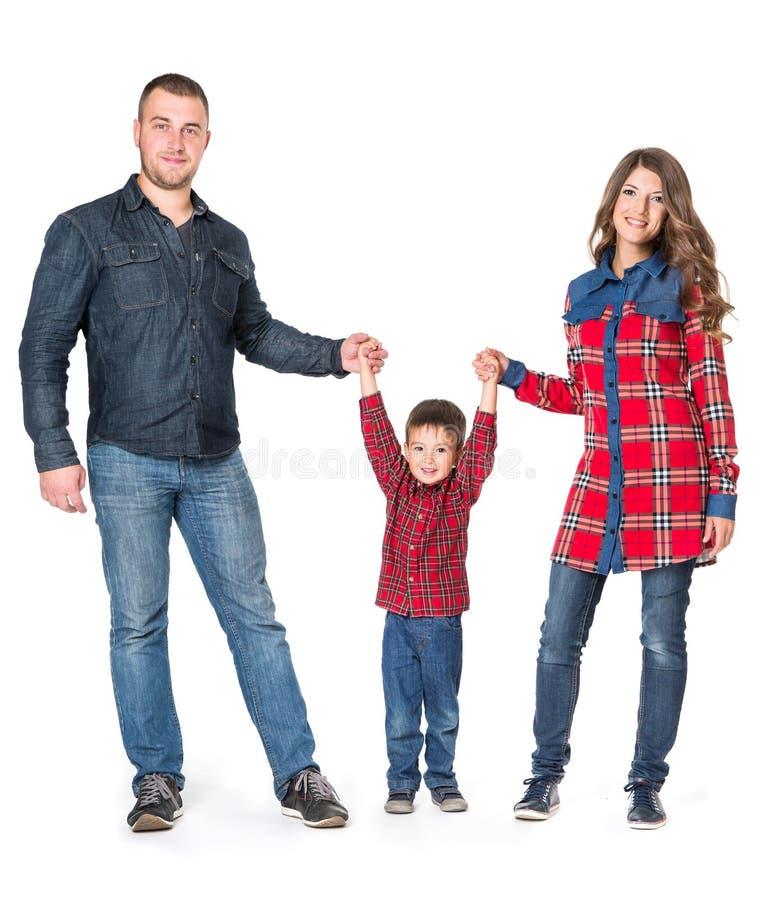 家庭被隔绝在白色背景,全长夫妇的孩子 库存图片