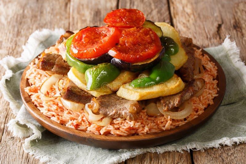 家庭阿拉伯烹调:Maklouba或Makloubeh或者Makloubi米与 免版税库存照片
