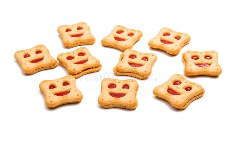 家被隔绝的做的曲奇饼面带笑容 库存图片