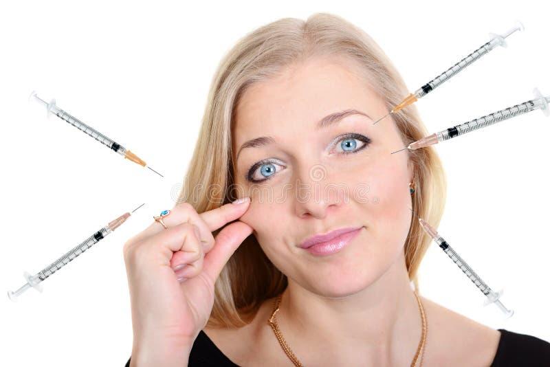 整容手术一名妇女的秀丽画象有注射器的 库存照片