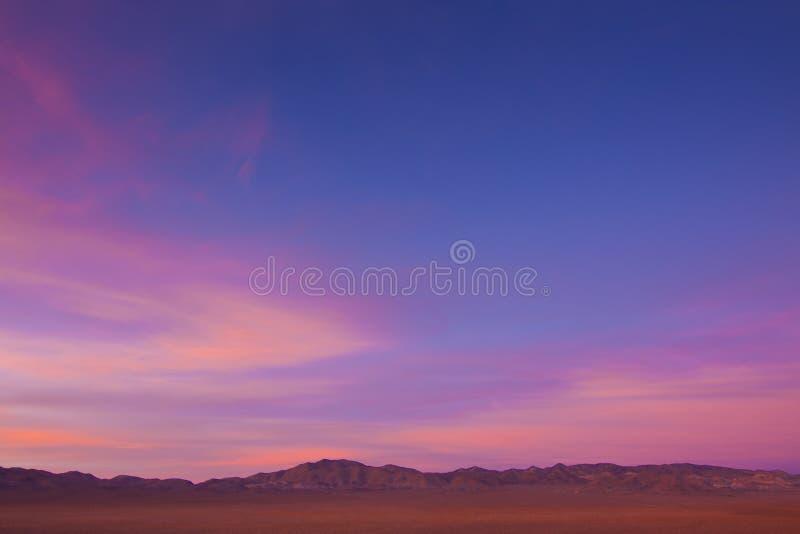 宽沙漠开放的日落 免版税图库摄影