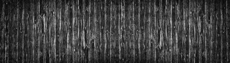 宽老黑多节的木纹理 黑暗的板条毛面 木板全景背景 库存图片