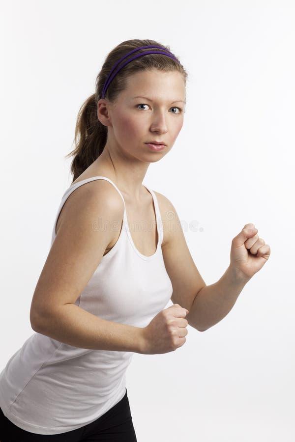 富挑战性的看起来运动的妇女 库存图片