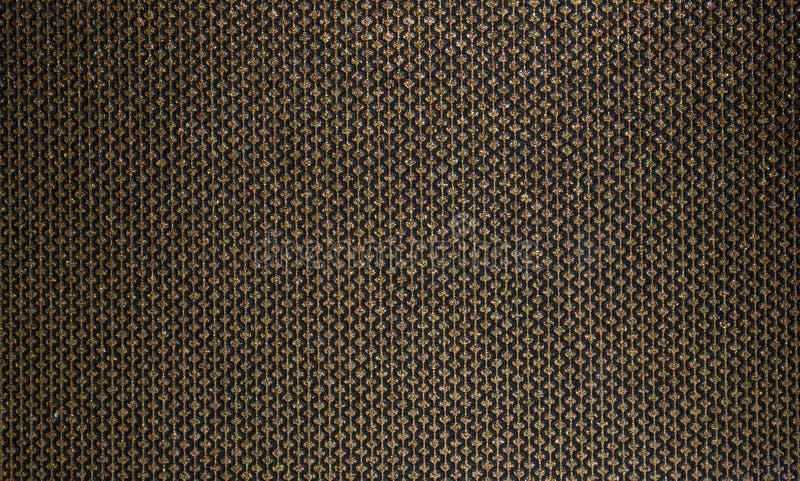 富有、蜂蜜纹理织品的和墙纸 金子排行与金刚石的样式在黑背景 库存照片