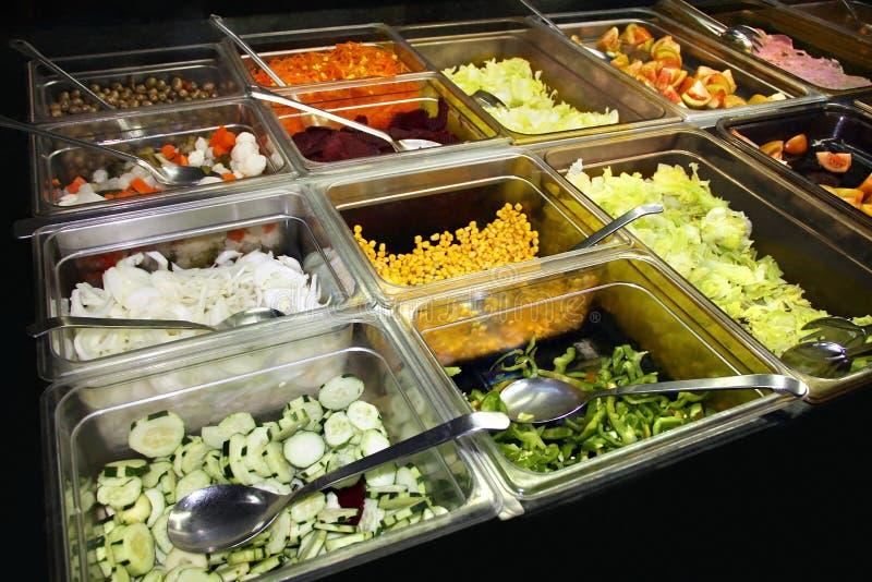 富有桌用不同的五颜六色的食物 图库摄影