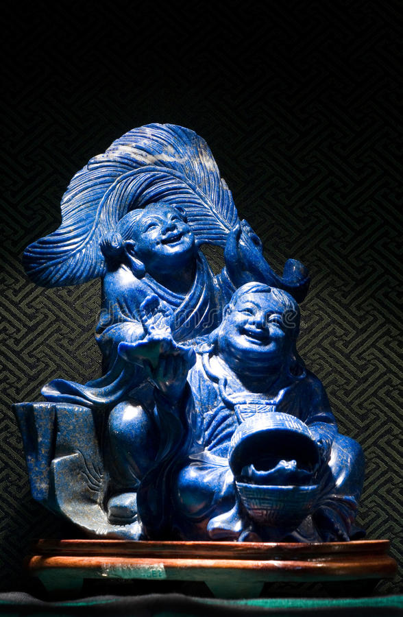财富的上帝蓝色玉雕塑在中国 库存照片