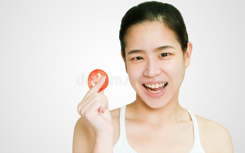 对一名亚裔妇女的面孔的特写镜头 免版税库存图片