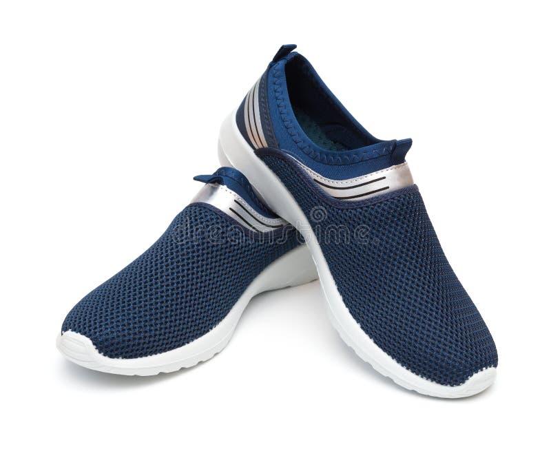 对人的蓝色运动的鞋子 图库摄影