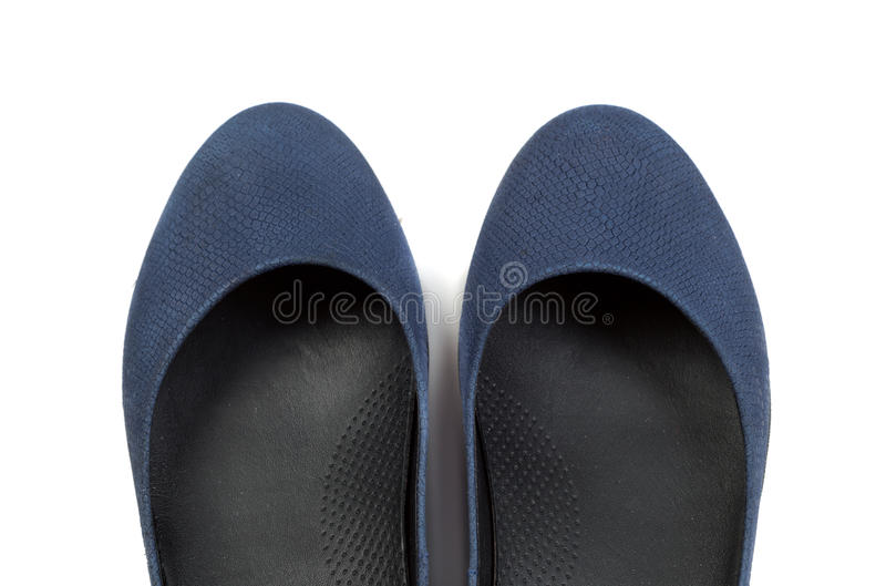 对体育妇女` s运动鞋,在一个白色特写镜头的孤立 免版税库存照片