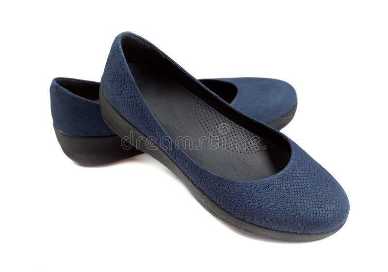 对体育妇女` s运动鞋,孤立 免版税图库摄影