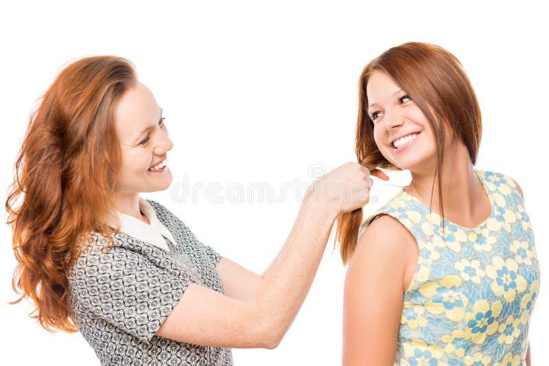 对发型做的美丽的女孩她的朋友 库存照片