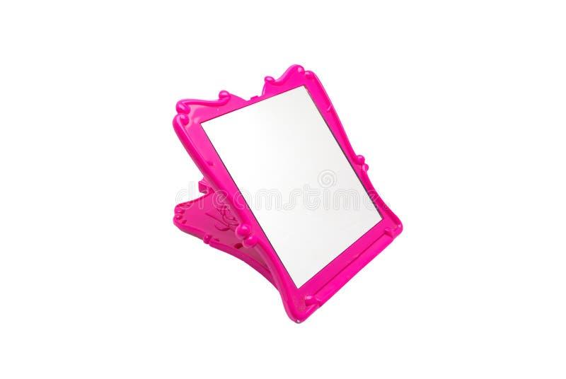 对可折叠的美丽的鲜粉红色镜子的特写镜头,被隔绝 图库摄影