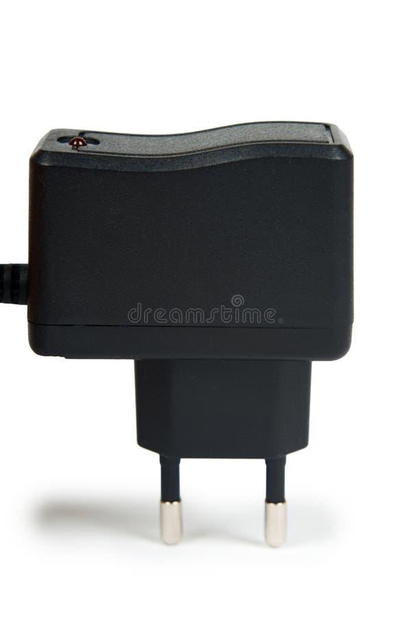 对在白色背景隔绝的直流电功率适配器的黑插座AC 库存图片
