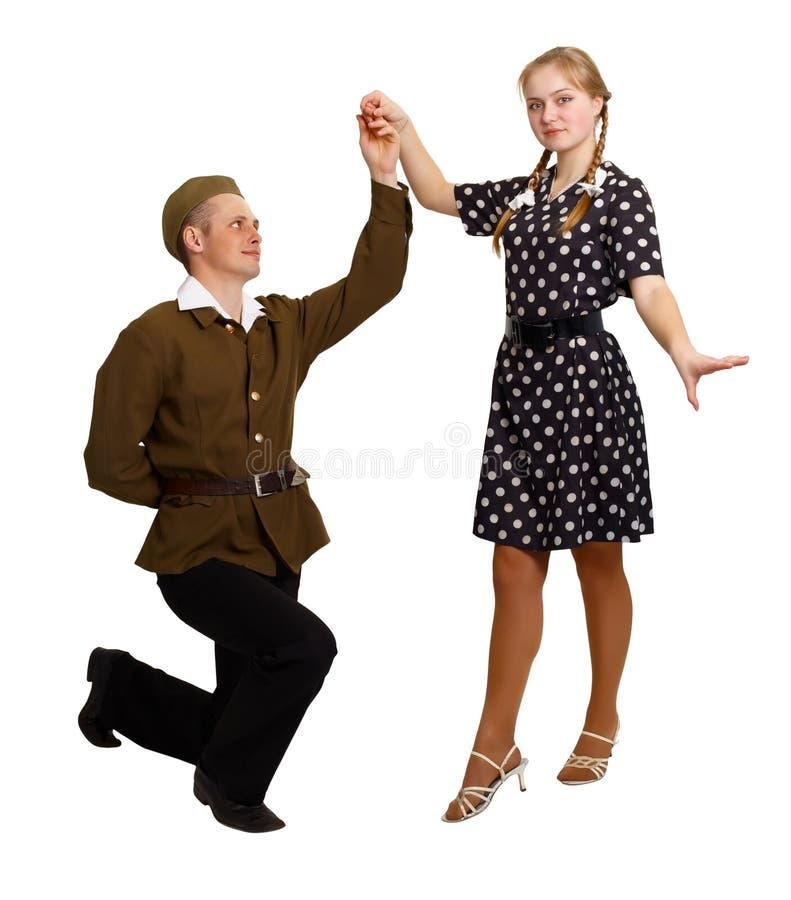 对在60s的服装执行一个舞蹈 库存照片