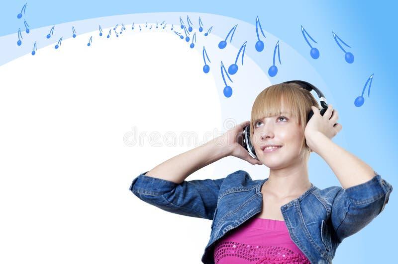 对妇女年轻人的有吸引力的列表音乐 库存照片