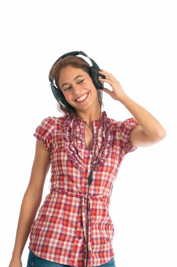 对妇女年轻人的种族听的多音乐 库存照片