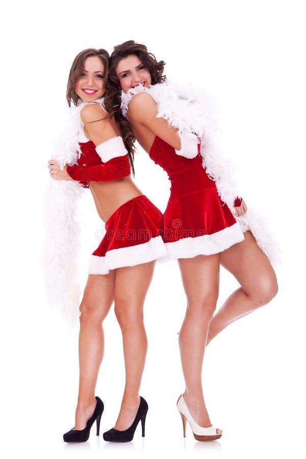 对妇女的回到圣诞老人 免版税库存图片