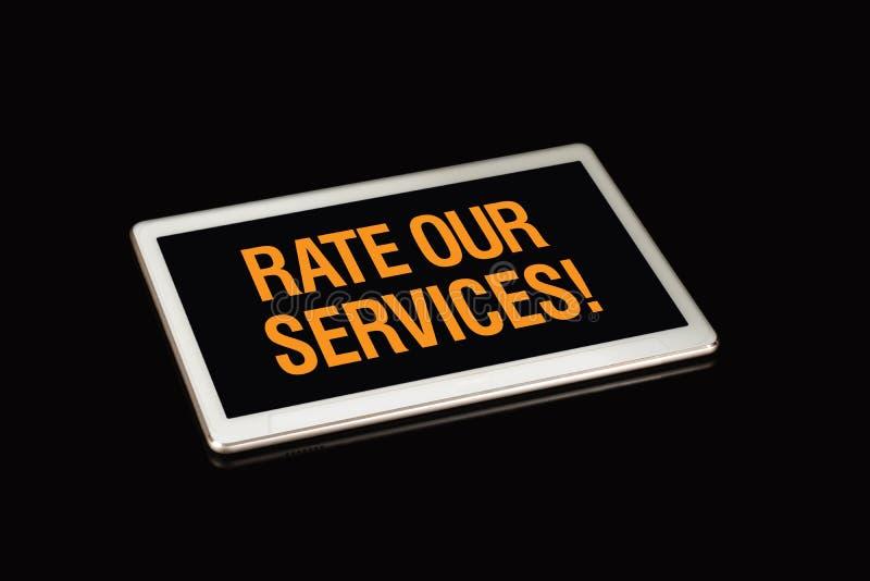 对我们的服务估计签字,wrritten在片剂屏幕上 免版税库存图片
