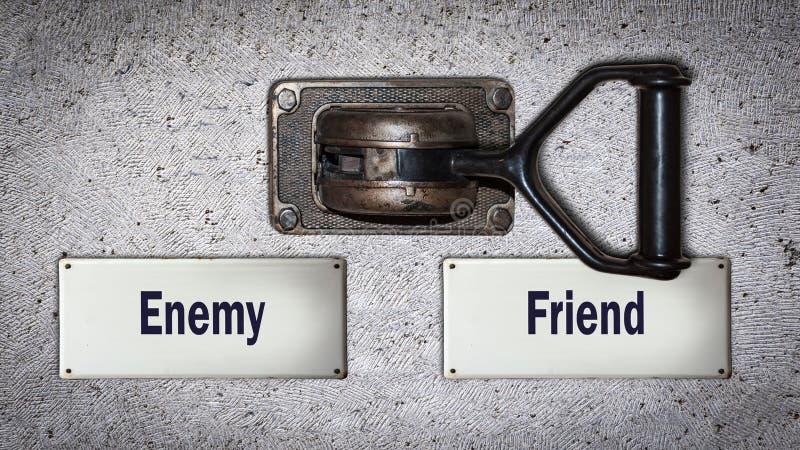 对朋友的墙壁开关对敌人 库存图片