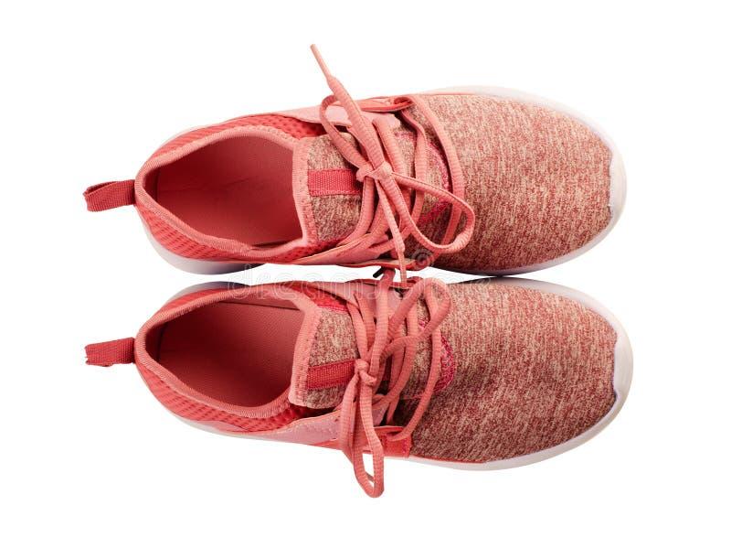 对桃红色运动鞋 免版税库存照片