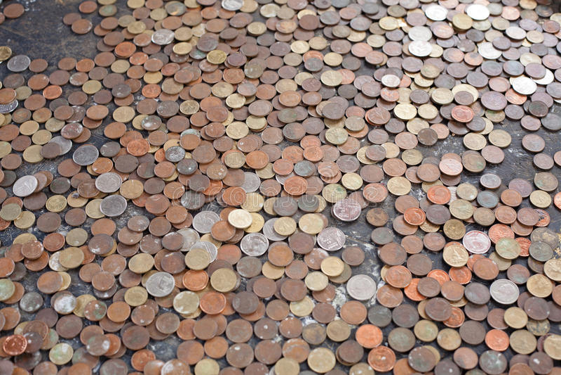 对泰国寺庙的硬币捐赠 库存图片
