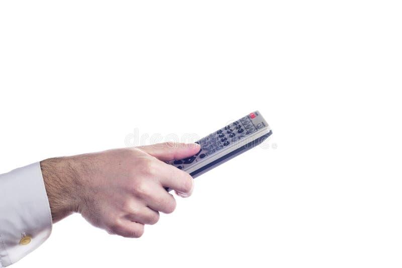对电视遥控负的手被隔绝在白色背景 库存照片