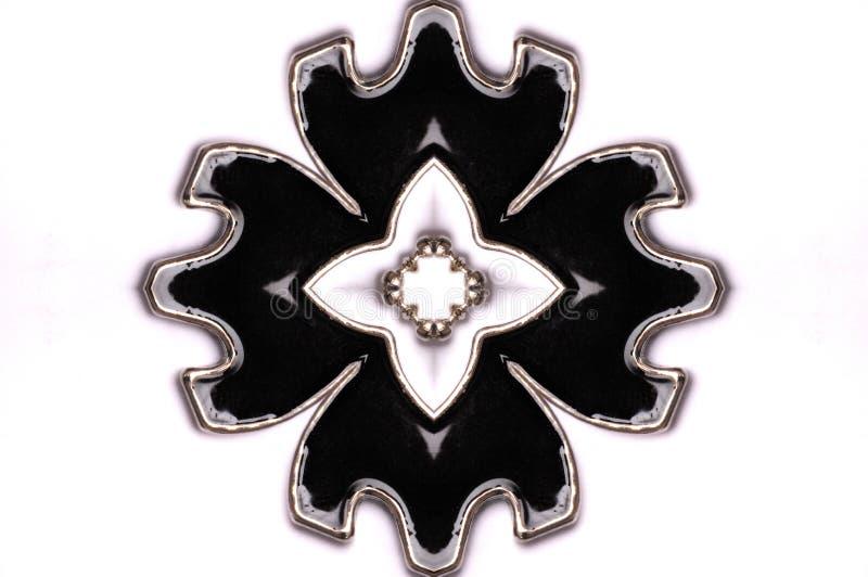 对称花瓣形状的垂饰 免版税库存照片