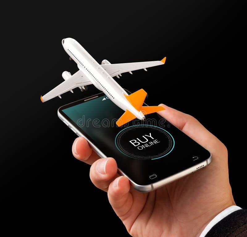 对网上搜索,买和预定飞行的智能手机申请在互联网上 库存照片