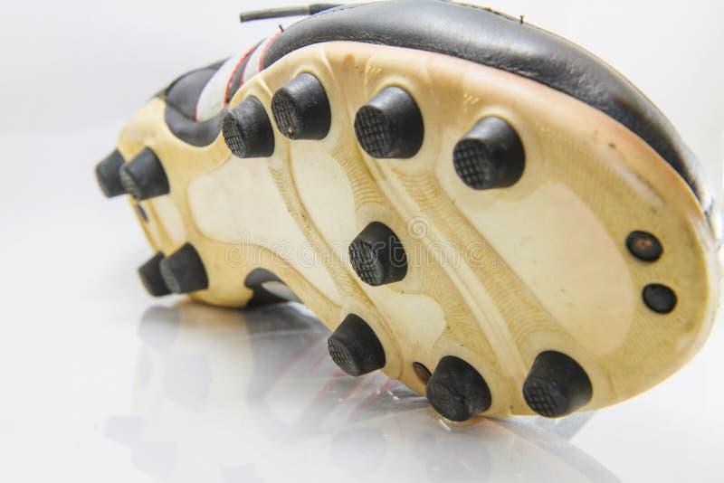 对足球鞋子按钮的选择聚焦  免版税库存图片