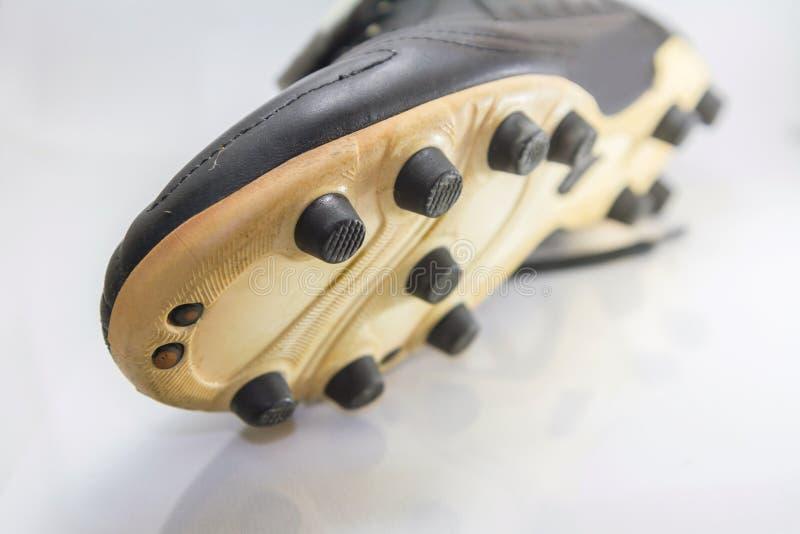 对足球鞋子按钮的选择聚焦  库存照片
