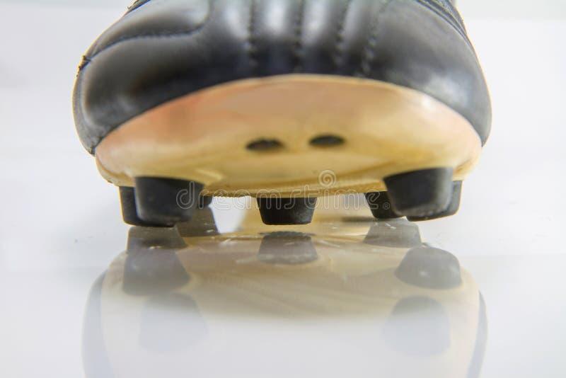 对足球鞋子按钮的选择聚焦  免版税图库摄影