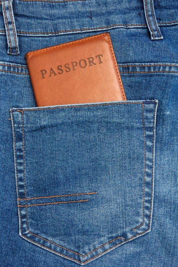 对非常突出从的护照的接近的看法蓝色牛仔裤装在口袋里 库存照片