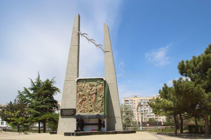 对驱逐出境的受害者的纪念碑在Evpatoria镇,克里米亚 库存照片