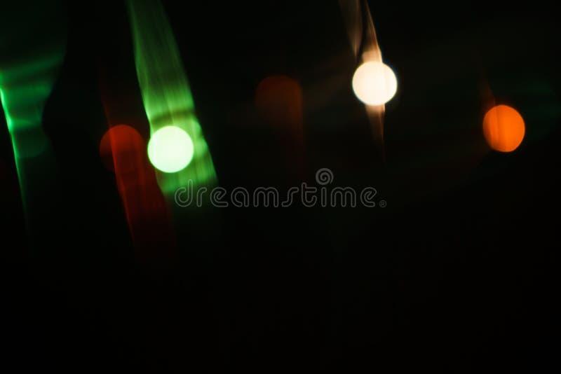 对黑暗的背景的透镜火光光学作用 免版税库存图片