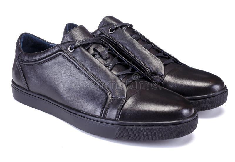对黑颜色运动鞋称呼在白色背景隔绝的人鞋子 库存图片