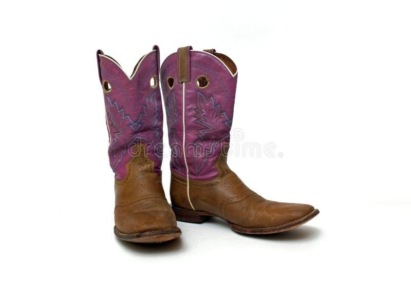 对破旧的妇女的牛仔靴 免版税库存照片