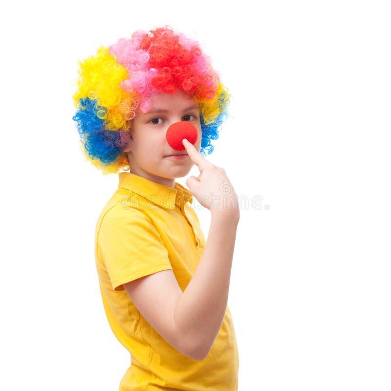 对他的鼻子的年轻小丑点 免版税图库摄影