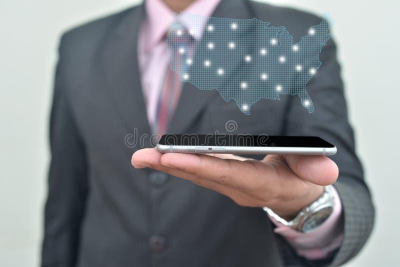 对Iphone6负的一个装饰的人手中 免版税库存图片