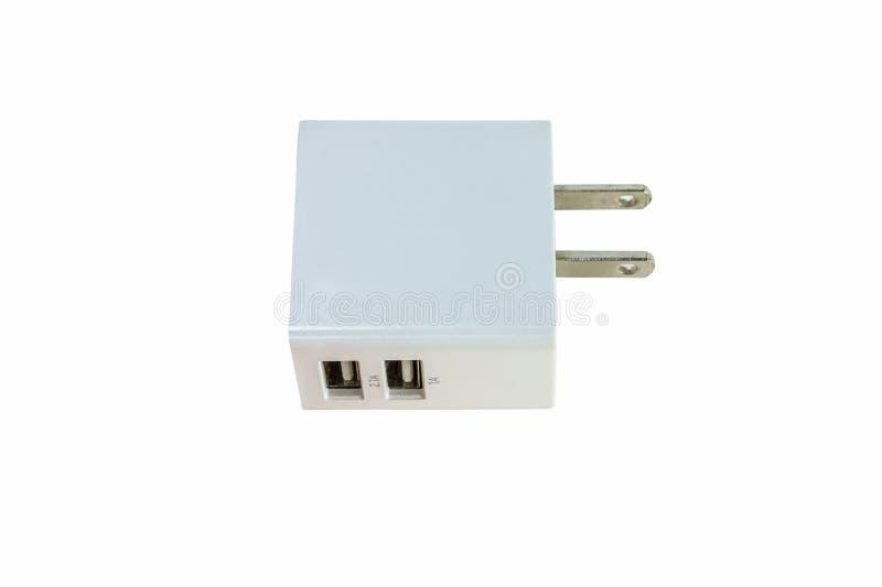 对USB充电器口岸的双重电子适配器 库存照片