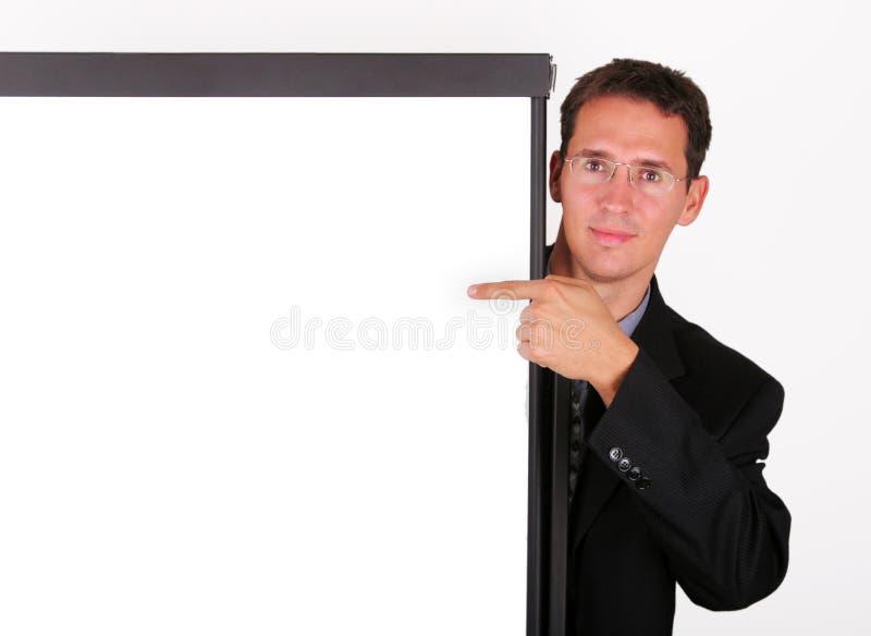 对whiteboard的商人点 免版税库存照片