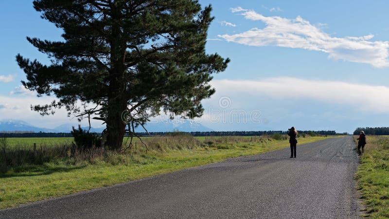 射击空的风景的摄影师 免版税库存照片