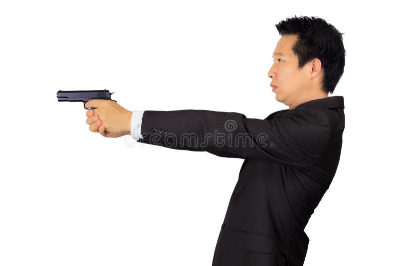 射击在白色的亚洲男性一杆枪 库存图片