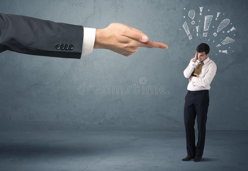 射击有罪商人的上司手 免版税库存照片