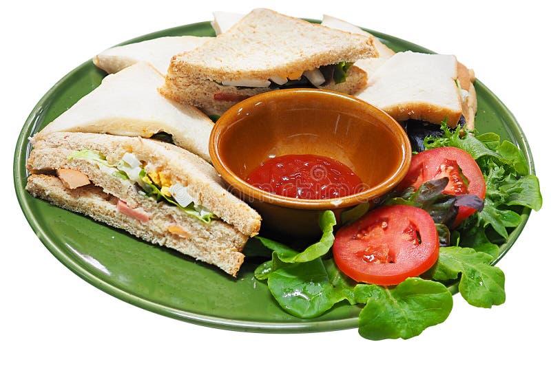 将在白色背景和番茄酱,侧视图夹在中间隔绝的面包 库存图片