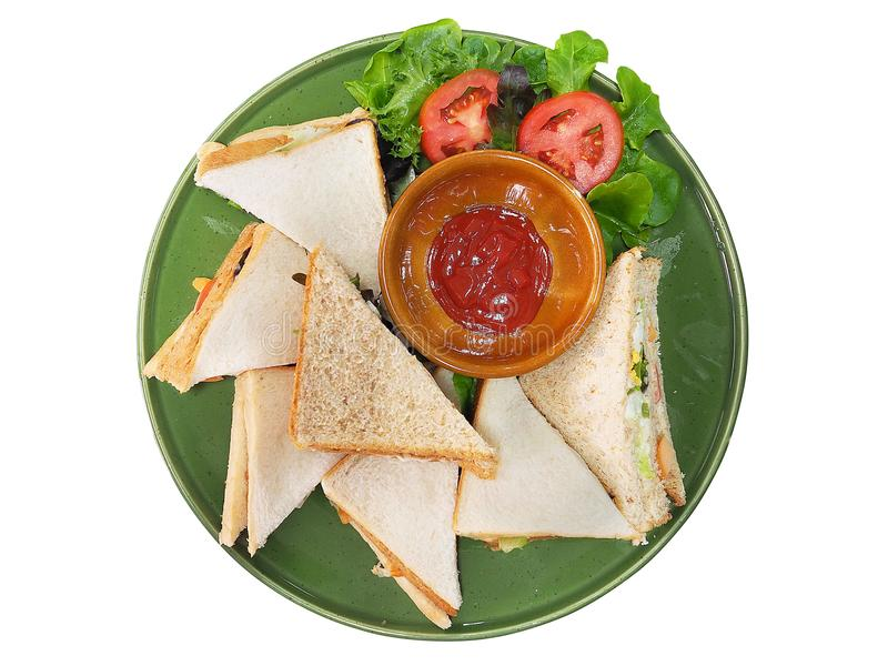 将在白色背景和番茄酱,顶视图夹在中间隔绝的面包 免版税图库摄影