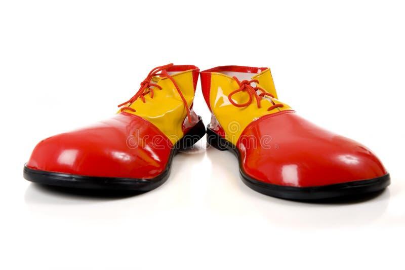 小丑穿上鞋子白色 免版税库存照片