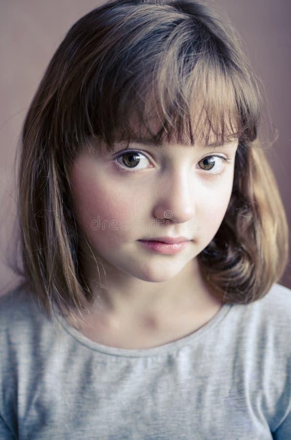 小俏丽的女孩的画象 图库摄影
